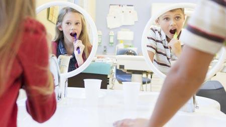 تیر کشیدن دندان های کودک